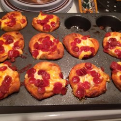Easy Pepperoni Pizza Muffins Recipe - Pepperoni pizza muffins are a quick and easy snack made simple by using refrigerated biscuit dough.