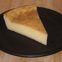 Elva's Custard Pie Recipe - A simple egg custard pie delicately flavored with nutmeg and vanilla.