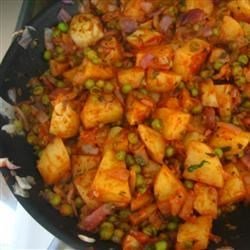 Aloo Matar Recipe - Potatoes and peas are cooked in a tomato sauce with Indian seasonings.
