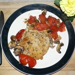 Roasted pork chops with tomatoes,mushrooms,and garlic sauce