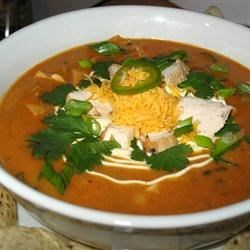 Chicken Enchilada Soup III Recipe - Shredded chicken is simmered with masa harina, enchilada sauce and Cheddar cheese in this easy soup.
