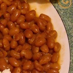 Mom's Baked Beans I Recipe - Liquid smoke flavoring and barbecue sauce give these beans a unique flavor.  Delicious hot or cold!