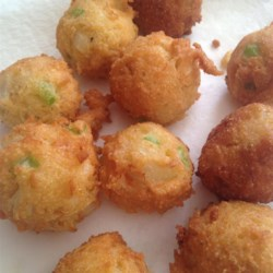 Vicki's Hush Puppies Recipe - This is a simple, no-fuss recipe for savory cornmeal fritters. Eggs are combined with sugar, onion, self-rising flour and cornmeal, and then deep-fried.