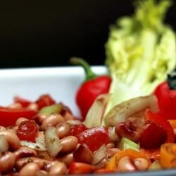 Black-Eyed Pea Salad Recipe - Toss together black-eyed peas and assorted colorful vegetables, sprinkle with a balsamic vinaigrette, and enjoy!
