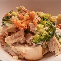Broccoli Chicken Casserole I Recipe - Assembly time is minimal with this simple casserole combining chicken, cream of mushroom soup, cheddar cheese and broccoli. Dry stuffing mix is sprinkled over the top for a crunchy, flavorful topping.