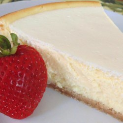 Waldorf's Sour Cream Cheesecake  Recipe - Sour cream cheesecake baked over a vanilla wafer crust is a delightful dessert for special occasions and holidays.