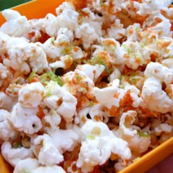 Sriracha-Lime Popcorn Recipe - Fresh-popped popcorn is seasoned with lime juice, lime zest, and sriracha for a zesty snack for lovers of spicy food.