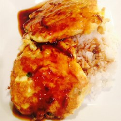 Shrimp Egg Foo Yung Recipe - Vegetables and cooked shrimp are combined with beaten eggs then fried and shaped into patties. Served with a thick and hot sauce made with chicken broth and soy sauce.
