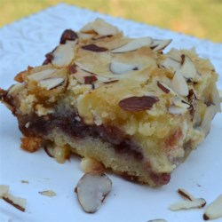 Berry Almond Bars Recipe - Delicious bar cookie that uses white or vanilla chips in the batter.  You can use any flavor of berry jam you'd like.