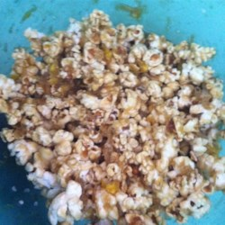 Soft Caramel Corn Recipe - This soft, yummy caramel corn will disappear before your eyes!  Great for the holidays, parties, or gifts.  I promise, this easy recipe won't let you down!