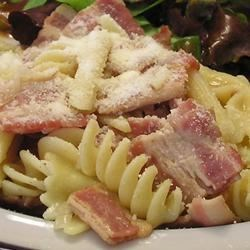 Pat's Simple Penne Recipe - Add cooked penne to a simple sauce of bacon, browned onions, chicken broth and pepper flakes, let the flavors come together, then serve it up for a quick and tasty meal.