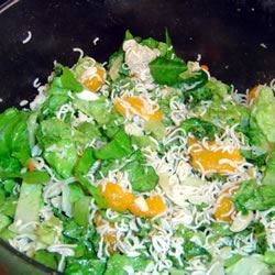 Chinese Noodle Salad Recipe - Sweet mandarin oranges, crunchy ramen noodles, and slivered almonds are tossed with romaine lettuce and a rice vinegar, sugar, and oil dressing to create a tangy salad that will win you over.