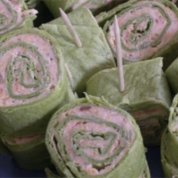 Tortilla Rollups II Recipe - Tortilla rollups filled with a smooth blend dominated by Cheddar cheese and green onions. Adjust the recipe to taste. It is very simple and good. Enjoy!