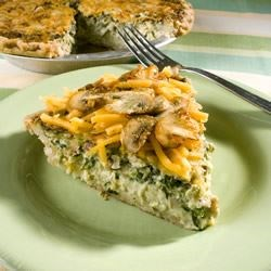 Belle and Chron's Spinach and Mushroom Quiche Recipe - Swiss and Cheddar cheeses are baked into this veggie and bacon quiche that's certain to please.