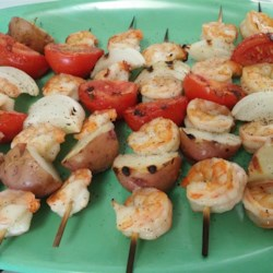 Meal on a Stick - Shrimp Kabobs Recipe - Peeled shrimp are grilled alongside chunks of potato, onion, and tomato in this simple meal on a stick.