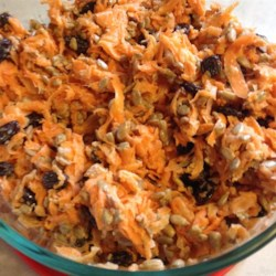 Thanksgiving Carrot Salad Recipe - A sweet and creamy carrot salad made just 5 ingredients has a pretty color and the flavors of coconut and raisins. All you do is mix it up, chill it, and serve it.
