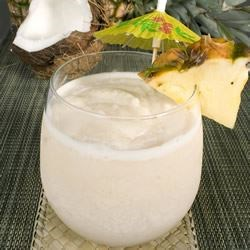 Pina Colada IV Recipe - This recipe was originally created by a man called Monchito in Puerto Rico in 1954. Coconut, pineapple and rum blended with cream and ice.