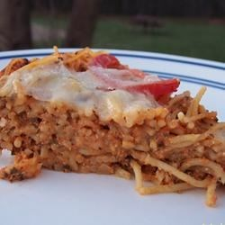 Spaghetti Torte Recipe - Don't tell your guests that the springform pan should get the credit for this beautiful torte. Cheese, tomatoes and basil are layered with pasta spruced up with egg whites, ricotta cheese, Italian seasoning and Parmesan.