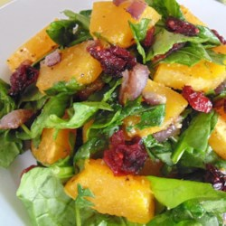 Roasted Butternut Squash with Onions, Spinach, and Craisins(R) Recipe - Roasted butternut squash and onions are tossed with spinach, dried cranberries, and nuts for a colorful side dish during the autumn months.