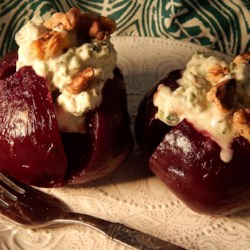 Baked Beet Root With Yogurt Walnut Dressing Recipe - This dish will look superb on your table anytime of year, but is especially good as a cool summertime course. The beets are served at room temperature with a chilled yogurt dressing.