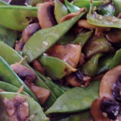 Stir Fried Snow Peas and Mushrooms Recipe - Snow peas and sliced mushrooms are tossed with sesame seeds and teriyaki sauce.