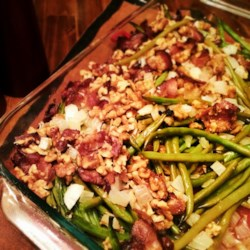 The Most Delicious Green Beans Recipe - A tasty new way to serve green beans! Fresh green beans are marinated in a sweet and tangy dressing and baked with bacon, onion, and slivered almonds.