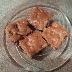 Cinnamon Coffee Bars Recipe - This quick and easy bar cookie has raisins and nuts in it and is great with a hot cup of coffee or a cold glass of milk.