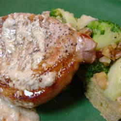 Pork Chops with Blue Cheese Gravy Recipe - This recipe makes the most delicious creamy blue cheese gravy to serve over pork chops. It tastes like something from a fancy restaurant. Serve with sauteed mushrooms, if desired