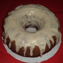 Holiday Pumpkin Cake with Rum-Cream Cheese Glaze Recipe - Pumpkin puree is the key ingredient in this moist bundt cake topped with a luscious rum-cream cheese glaze. It will give any pumpkin pie a run for its money!
