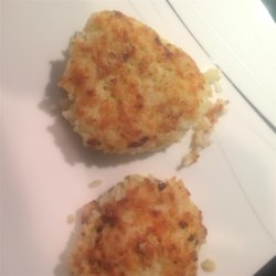Rice Patties Recipe - Leftover rice is mixed with cheese, egg, and seasoning to make pan-fried patties that will have you planning for leftover rice in the future.