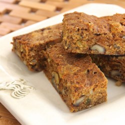 Carrot and Raisin Bars Recipe - Spiced carrot and raisin bars with walnuts and a hint of orange taste just like carrot cake in the form of a cookie bar.