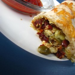 Karin's Veggie Calzones Recipe - These vegetarian calzones are chock full of veggies. Make it your own by adding your favorites, such as spinach, mushrooms, zucchini, artichokes, and olives.