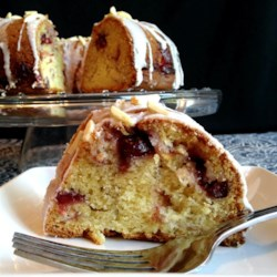 Sandy's Cranberry Coffee Cake Recipe - Coffee cake with a hint of almond and layers of cranberry sauce is the perfect way to start Christmas or Easter morning.