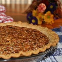 Priceless Pecan Pie Recipe - This is an all time favorite Thanksgiving dessert. It has layers of creamy cheesecake, crunchy pecans, and smooth custard.
