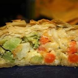 Vegetable Filo Pie Recipe - Filo dough is filled with a mixture of your favorite vegetables and feta cheese.