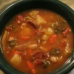 Portuguese Bean Soup Recipe - This hearty, delicious, and filling Portuguese sausage, cabbage, and bean soup was passed down from my grandmother. This rich soup is perfect for fall and winter when you need something hearty to keep you going.