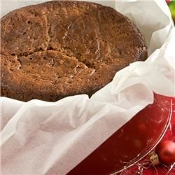 Christmas Fruitcake Recipe - It's a shame that fruitcake as a species gets such a bad rap.  With its two key ingredients - rum and butter - it ought to be a hit.  This recipe includes dried fruit, instead of the glowing, candied stuff we've all learned to associate with fruitcake, and is less dense and more cake-like than many fruitcake recipes.  It has become a favorite of my friends and family around the holidays (even the skeptical ones), and is delicious by itself, or covered with a layer of almond paste.  Fruitcake is also traditional for wedding cake in England, and makes a very rich, sophisticated dessert for luncheons or teas.