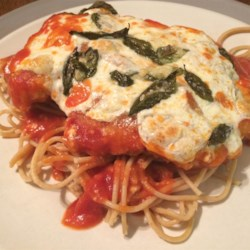 Chicken Parmesan Recipe - A classic Italian dish prepared with tomato sauce and mozzarella, with a few additions by Chef John. Sure to impress your friends and family!