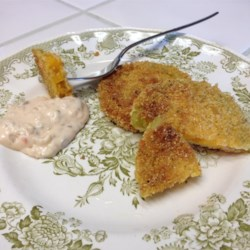 Chef John's Fried Green Tomatoes  Recipe - Discover the tangy, fresh taste of sliced green tomato, rolled in cornmeal breading and fried to a golden brown. Serve with a dollop of spicy remoulade sauce you whip up in seconds.