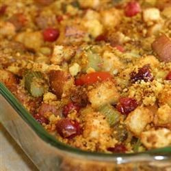 Sausage Dressing Recipe - This wonderful sausage stuffing is bursting with the flavors of fresh herbs, cranberries, orange, and walnuts.