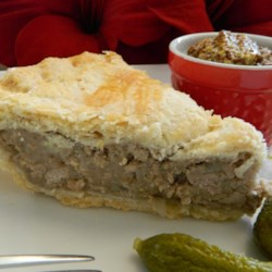 Terri's Tourtiers (French-Canadian Santa Pies) Recipe - Tourtiers--French-Canadian pork pies--are a traditional dish made during the holiday season. Serve each slice with cornichons and grainy Dijon mustard.
