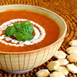 Creamy Tomato Soup (No Cream) Recipe - This creamy tomato soup recipe is made creamy without cream, thanks to bread cubes and butter pureed into the soup.