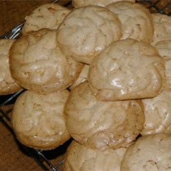 Peanut Butter Kisses I Recipe - This recipe uses peanut butter in a unique take on the crumbly flour-less divinity cookie made primarily with egg whites.
