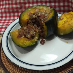 Squash Stuffed With Dates and Onion Recipe - Make the most of buttercup squash by stuffing with a bacon, onion, and date filling and baking until tender.