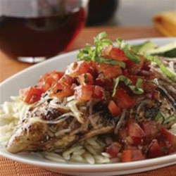Bruschetta Chicken Recipe - All the flavors of bruschetta on top of juicy grilled chicken!