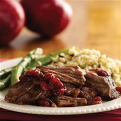 Pot Roast with Cranberry Pomegranate Sauce Recipe - Rich browned roast beef is accented with the subtle sweetness of cranberries in a savory sauce.