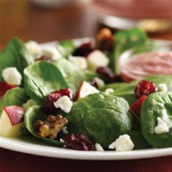 Spinach Salad with Pomegranate Cranberry Dressing Recipe - Sweet fruit is wonderfully accented by the tangy salad dressing. Add leftover cooked chicken or turkey and you've got a wonderful main dish salad.