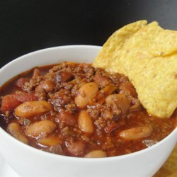 The Ultimate Slow Cooked Chili Recipe - Ground beef, plenty of beans, Mexican-style tomatoes, and a nice balance of seasoning creates the ultimate slow cooker chili for chilly days.