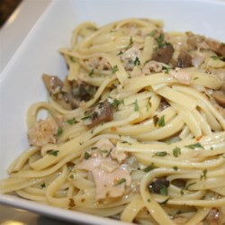 Linguine with Garlicky White Clam Sauce Recipe - A clam sauce made with canned clams and it's juices, wine, anchovies, and garlic dresses linguine for a quick and reasonably elegant pasta dish.