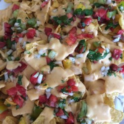 Homemade Nacho Cheese Sauce Recipe - This nacho cheese sauce is perfect for your next party or game day get-together. Three kinds of cheese are melted into a thick and creamy white sauce. Spice it up as much or little as you like!